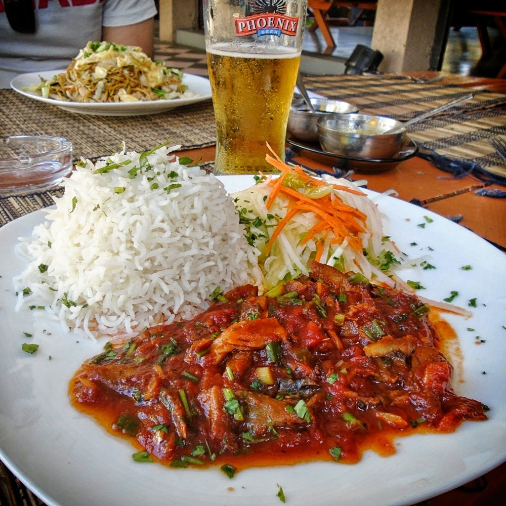 Salted Fish Rougaille, served with rice and salad at a local restaurant in Trou-aux-Biches.